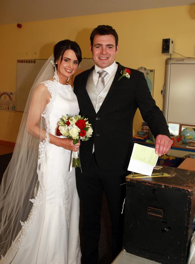 Newlyweds Sarah Clare and Joe Sinnott as Joe casts his vote at Monaseed NS in Gorey on Friday