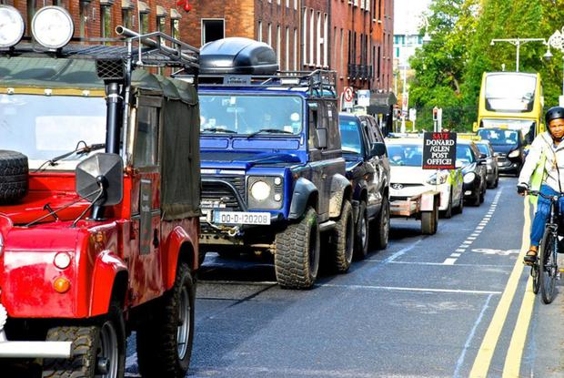 The motorcade of 4x4 vehicles on their way to Leinster House.