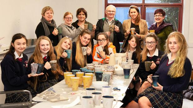 The group of St Mary's students working on their pottery projects at Solace Pottery Studio in Arklow.