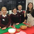 Ms Lee with Jasmine, Ciara and Isabelle in the Home Economics room