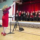 Dara MacMahon conducting the Move4Parkinsons Choir at the Wicklow Sings Festival at Temple Carrig School, Greystones, in April