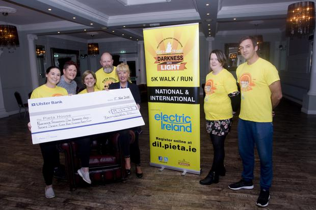 Una Cosgrave Hanley, Lorainne Whelehan, Pam Nicholison, Gavin Farnan, Barbara Morris from Pieta House fundraising, Mags O'Toole and Keith Navel at the presentation of over €19,000, the proceeds of the 2018 Baltinglass Darkness into Light