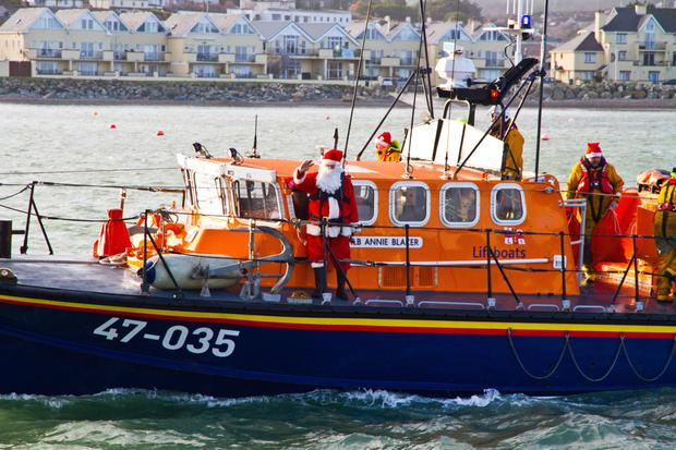 The Annie Blaker drops Santa Claus off at the Lifeboat Station in Wicklow town