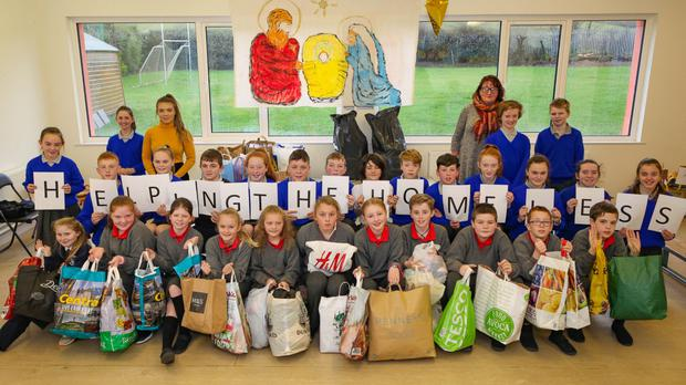 Students of St Joseph's Glenealy wth their collection of items to help make special packs to help the homeless clients of the No Bucks Café