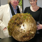 Sarah Eva Manson with Galway arts officer James Harold and her globe