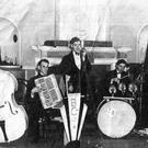 Terry - seated, playing the accordion - as a young man.
