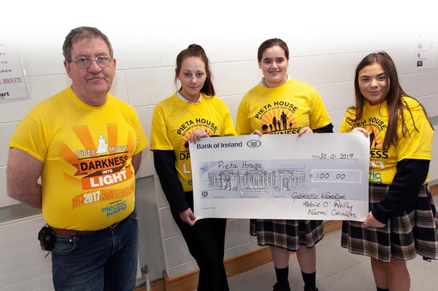 Jimmy Myler of The Vault accepting the cheque on behalf of Pieta House, from Naomi Crinion, Abbie O'Reilly and Gabrielle Werder