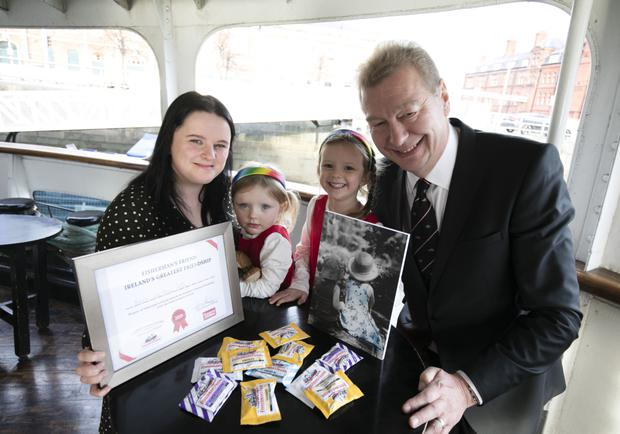 Claire Duffy and her daughters, Anna (3) and Neala (4) from Newtownmountkennedy with Jon White from Fisherman's Friend and Claire's photo of her girls, which won the 'Ireland's Greatest Friendship' competition