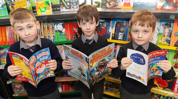 Jenson Nolan, Conor Kelly and Tadhg Sheehan at the book fair at Rathdrum BNS