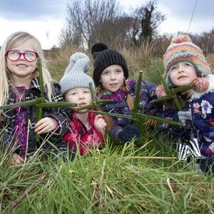 Maeve Cleary, Siún Lynch, Eva Lynch and Anne Lynch making St Brigid's Crosses at the East Coast Nature Reserve in Newcastle as BirdWatch Ireland celebrates World Wetlands Day