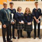 The Coláiste Chill Mhantáin team: Patrick Kehoe, Adelaide Kane Kayleigh, Claire Malone, Gary O'Connor with Pat O'Brien, Neville Byrne from Wicklow and District Lions.