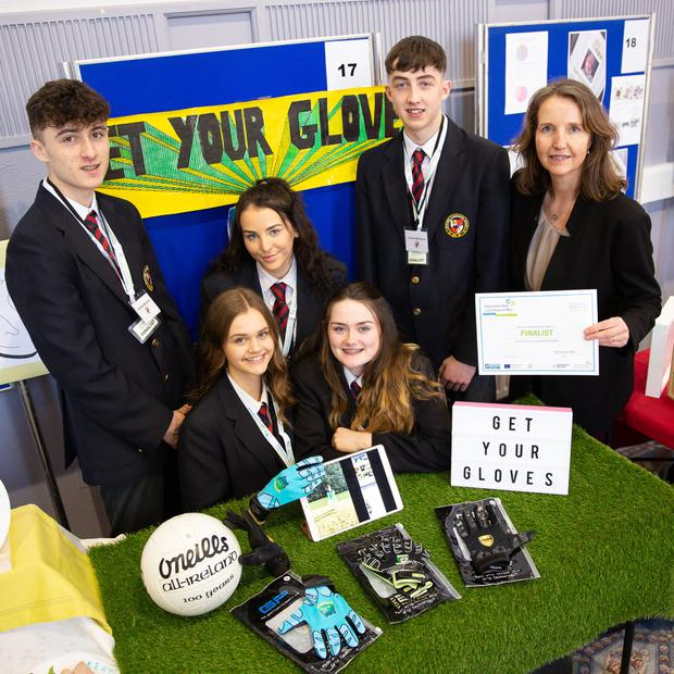 Andrew Bracato, Lucy Tarmey, Luaren o'Reilly, Mya Byrne and Cormac McGaynor from Avondale Community College show their business, Get Your Gloves, to Vibeke Delahunt, Head of Enterprise at LEO Wicklow, at the Wicklow Student Enterprise Awards. Photos by Barbara Flynn