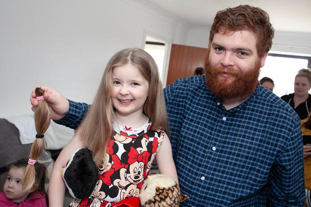 Proud dad Kieran with Hailey and the hair she donated to help sick children
