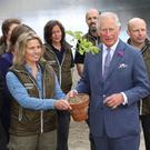 Members of the National Parks and Wildlife Service presenting Prince Charles with an oak seedling grown from a Glendalough acorn