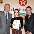 Eimear Carvill from Loreto Bray with Prof Gary Granville, chairman of the judging panel, and James Twohig from Valero