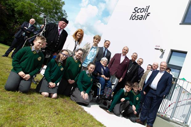 Pupils of St Joseph's with school principal Máire Daltúin, deputy principal Jimmy Doyle, Archbishop Diarmuid Martin, Cllr Miriam Murphy, members of the design team and members of McKelan Construction outside the new school extension, which was officially opened on Monday