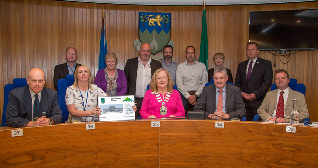 Members of Wicklow County Council and Cathaoirleach Cllr Irene Winters (centre in pink) at the signing of the contract for the new library in Wicklow town