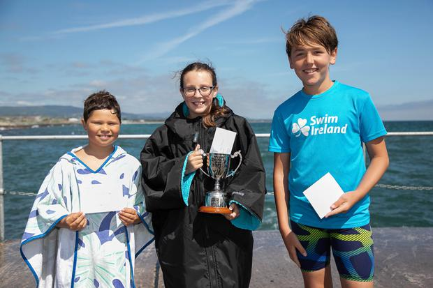 The top three finishers in the Shannen May Memorial Cup: Stephen Bell (second), Lucy Hornet (first) and Jacob Fry (third)