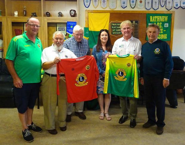 Lions members Santiago Balbontin, Nevill Byrne, Ethna Neiland, Sean Olohan and Maurice Corr presenting a new set of jerseys to Rathnew AFC U13 coach Declan Earls