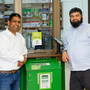 Muhammad Tanveer and postmaster Amjad Malik at Ballywaltrim Post Office