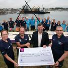 (Front) Vartry Rowing Club team captain Paula Keating, club chairman George O'Brien and team captain Garrett Whittington presenting the cheque to John Hickey, voluntary CEO of the St Vincent's Cancer Care Foundation, along with (back, from left) Dave Collard, Thomas Corkish, Kerrylee J Hempenstall, Leanne Manning, Thomas Hamill, Jason Dunne, Dale Flaherty, Liz Collard, Joe Quinn, Pascal Ryan, Jordan Ryan, Jim Kenny, Marie Fahy, Laurie Keogh, Hilda Cullen and Mary Doyle