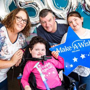 Rathnew's Poppy Mernagh (5) with her family after seeing her new disco-themed bedroom for the first time