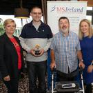 Damien Byrne (second from left), who received the MS Ireland Person of the Year Award, with (from left) Elsie Ryan, chairperson of the MS East Wicklow branch, Mark Mitchell, who nominated Damien, Ava Battles, CEO of MS Ireland, and Geraldine Dunne, Regional Community Worker at the coffee morning in the Arklow Bay Hotel