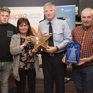 Inspector Seamus Rothwell accepts the Ciaran Jones Person of the Year Award on behalf of Mick O'Rourke from Michelle, Alan, Brenda and John Jones