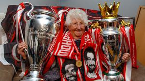 Maura Burke with the replica Champions League and Premier League trophies