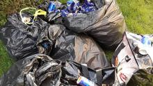 The contents of some of the bags of dumped rubbish.