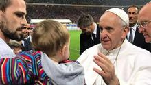 Leslie Martin with his son Ciaran who received a blessing from Pope Francis.