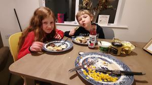 The Looby children enjoying their latest Where In The World meal