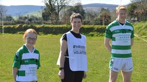 Saoirse and Orla Tyrrell with Ballymanus and Wicklow footballer Mark Kenny