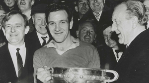 Séan O'Siochain presents the All-Ireland Junior Cup to Wicklow captain Paddy Reilly (RIP) at Croke Park