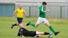 Avonmore's Paddy Kennedy slides on with a well timed tackle during the Premier clash with Wicklow Rovers last weekend.