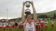 Tinahely captain Jackie Kinch lifts the Joe Jacob Cup after victory over Blessington in Baltinglass