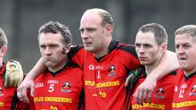 Don Jackman (11) surrounded by his Coolkenno team-mates ahead of the 2013 IFC final in Aughrim. Photo: Dave Barrett