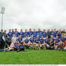 The Wicklow squad celebrate with the cup after the game
