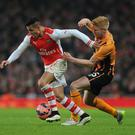 Alexis Sanchez of Arsenal holds off Paul McShane of Hull during the FA Cup Third Round match between Arsenal and Hull City at Emirates Stadium on January 4, 2015 in London, England. (Photo by Stuart MacFarlane/Arsenal FC via Getty Images)