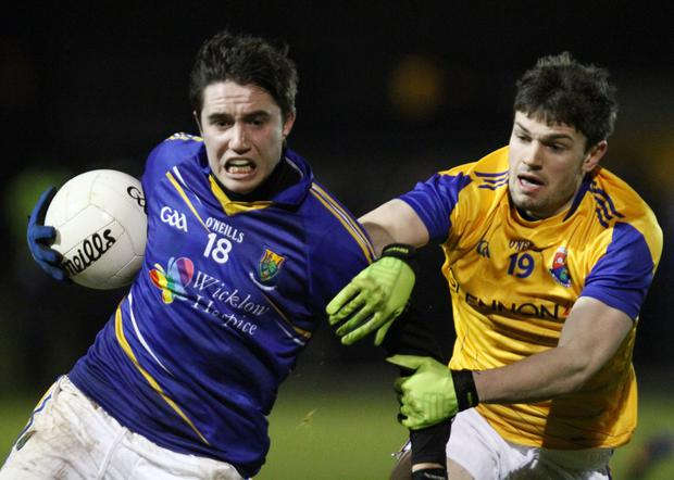 Wicklow's Conor Healy powers past Mattie Gorman in the Longford v Wicklow Leinster Under 21 Football Championship match at Newtowncashel (PHOTO - DAVE BARRETT) *Wicklow GAA Deal*