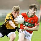 Ashford's Michael Traynor tries to hold on to Rathnew's Ronan Manley during the IFC in Dunbar park, Wicklow. Picture: Garry O'Neill