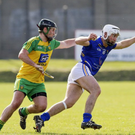 Donegal's Shane Gallen tries to hold on to Wicklow's Diarmuid Masterson during the NHL in Aughrim. Picture: Garry O'Neill