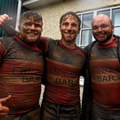 Wicklow players, from left, Shane Farrar, Niall Earls, and Timmy Donovan, celebrate after the game