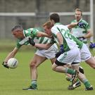 Ballymanus's Ray Stapleton reaches the ball ahead of Donar the Glen's John Hanbidge during the IFC in Aughrim
