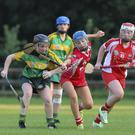 Knockananna's Claire Byrne comes under pressure from Glenealy's Ella Neary during the SCC in Glenealy