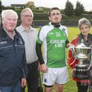 Avondale's captain Keith Byrne receives the Billy Byrne cup from Ann McDonald