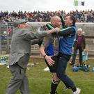 Will Wicklow GAA followers ever forget this photo? Highly unlikely. Bray's John Henderson had just guided his beloved Bray to the Senior hurling crown and when that final whistle sounded he turned to grab the nearest human being and share his joy and love and lo and behold who would that human being be only linesman on the day and well known referee John Keenan. It was a match made in heaven some might say. Others might use the phrase so popular among the young folk these days - 'awky momo'! Photo: Garry O'Neill