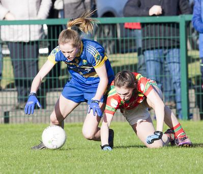 Wicklow's Claire Walsh battles for possession with Carlow's Ellen Atkinson