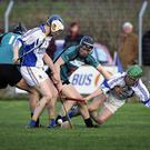 Wicklow's Martin O'Brien and Eugene Dunne try to prevent Maynooth University's Brian Molloy from gaining possession