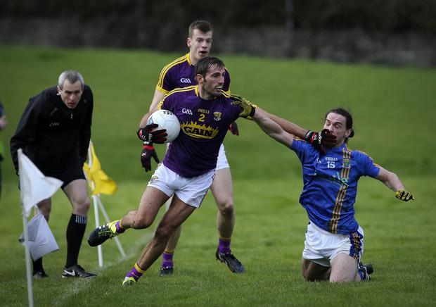 I've heard enough- Wexford's Brian Malone shakes off the challenge of Wicklow's Paul Cunningham. Photos: Garry O'Neill